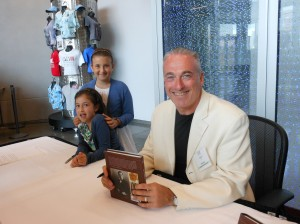 "Author Barry Singer, assisted by his daughters, sign his book ""Churchill Style"""